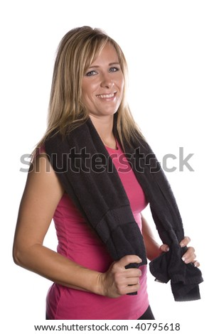A woman holding a towel around her shoulders after exercising. - stock photo