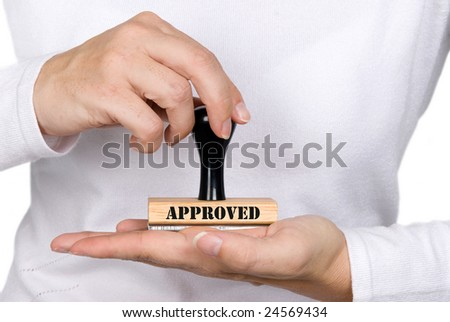 A woman holding an approval stamp - stock photo