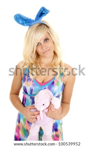 A woman holding her stuffed bunny close to her.