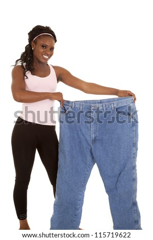 a woman holding out her big pants with a big smile