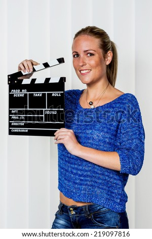 a woman holds a typical clapper in her hand - stock photo