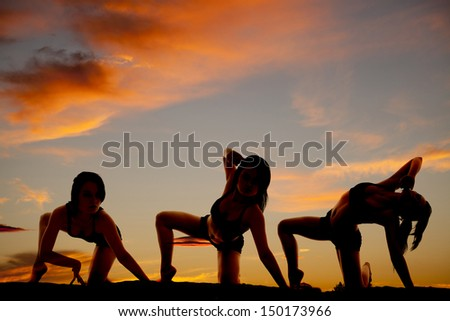 A woman in a bikini in the sunset in three positions. - stock photo