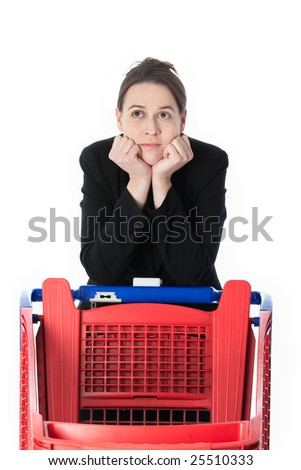 A woman in a business suit in a shopping scenario contemplating what to buy. - stock photo