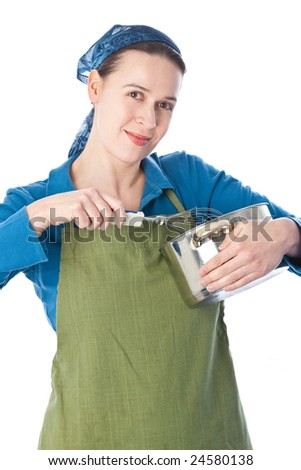 A woman in a domestic role preparing food on white - stock photo