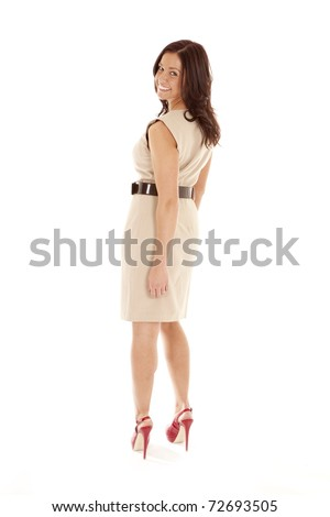 A woman in a dress and red shoes, view from the back. - stock photo
