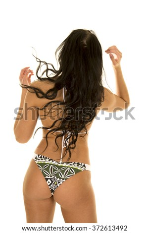 A woman in a green bikini from the back hands up - stock photo