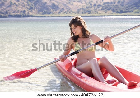 A woman in a kayak - stock photo
