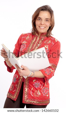 A woman in a red shirt reading a book