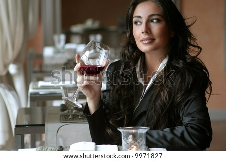 a woman in a restaurant - stock photo