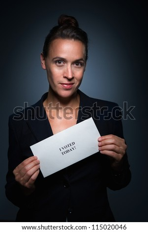 A woman in a suit charcterizing a woman who just voted - stock photo