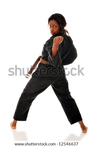 A woman in a threatening karate stance.  Isolated on white. - stock photo
