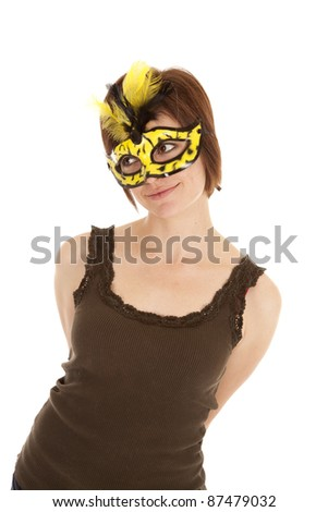 A woman in a yellow and black mask with a  small smile on her face.
