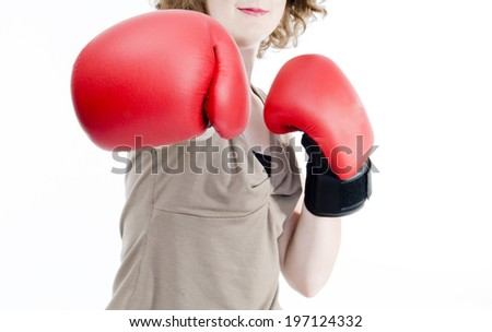 A woman in boxing gloves with one arm extended.