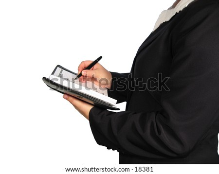 A woman in business suit holding a pen and an appointment calendar.
