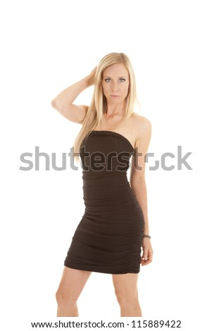 a woman in her black dress with a serious expression on her face. - stock photo