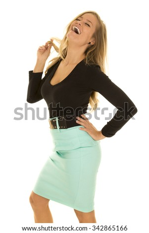 A woman in her business clothing, laughing and playing with her hair. - stock photo