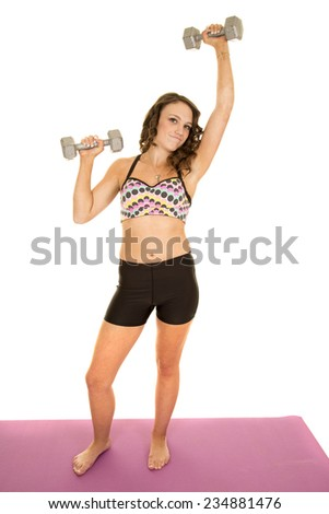 a woman in her fitness clothing lifting weights working out. - stock photo