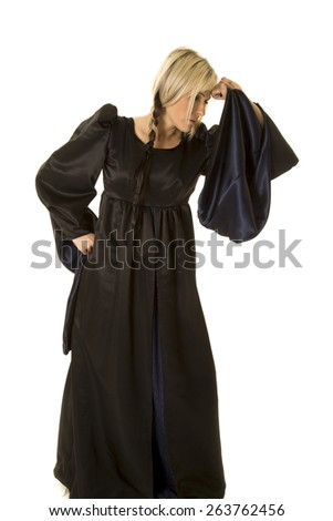 a woman in her medieval dress showing how upset she is. - stock photo