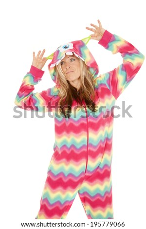 a woman in her monster pajamas playing around. - stock photo