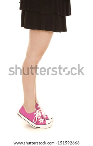 a woman in her pink shoes standing on her toes. - stock photo