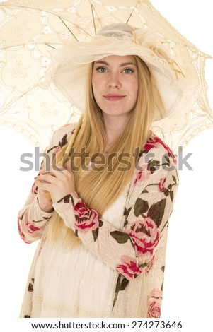 a woman in her sheer flower dress with her umbrella. - stock photo