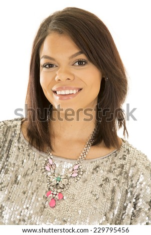 A woman in her silver dress with a big necklace around her neck. - stock photo