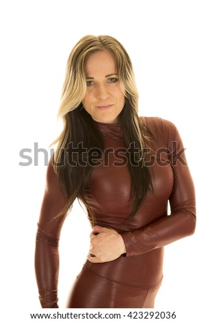 a woman in her tight fitting body suit with a smile on her lips. - stock photo
