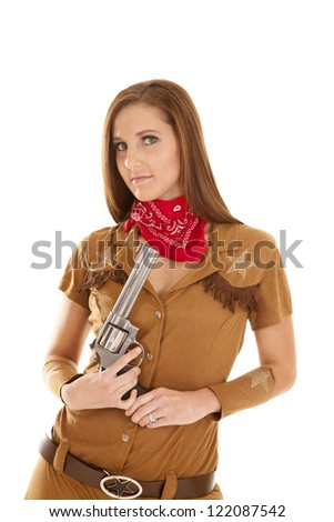 A woman in her western costume holding on to her gun. - stock photo