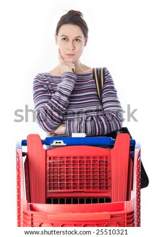 A woman in housewife role making a choice whilst shopping.