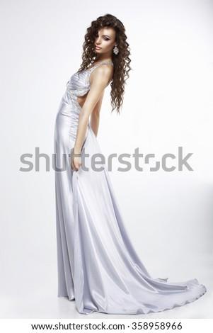 A woman in purple silk dress. Plume. - stock photo