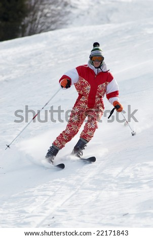 A woman in red at the ski slope