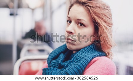 A woman in streetcar alone and depressed - stock photo