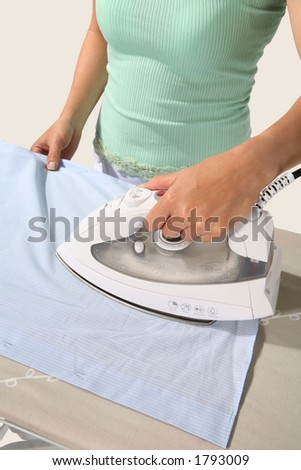 A woman ironing a shirt