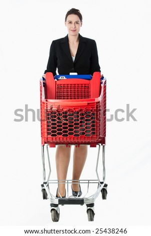 A woman is a business suit and an empty  shopping cart. - stock photo