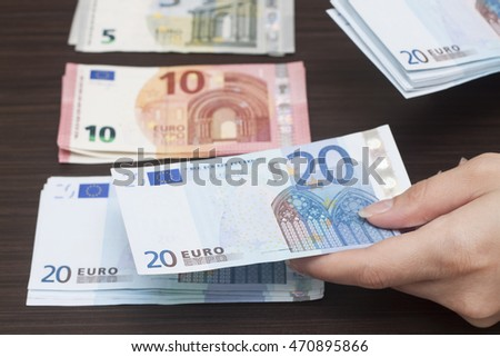 A woman is counting cash money, euro currency