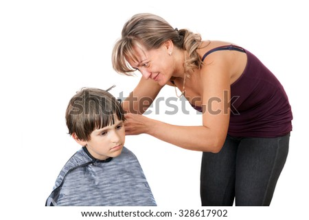 a woman is cutting a child, isolated on white background