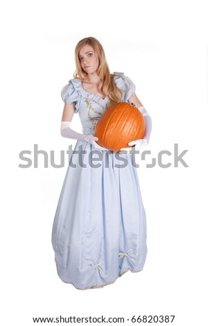 A woman is dressed like Cinderella and holding a pumpkin. - stock photo