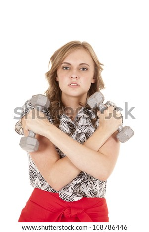 A woman is in a dress and holding some free weights. - stock photo