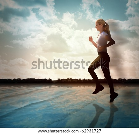 A woman is jogging for exercise on a beach with water and there are clouds in the sky. She has a silhouette fade. Use it for a health, sport or lifestyle theme. - stock photo