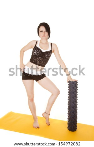 A woman is leaning on a mat roll. - stock photo