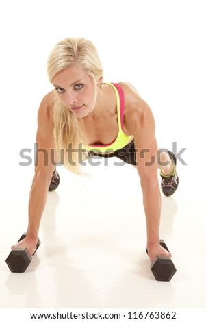 A woman is looking while doing a push up. - stock photo