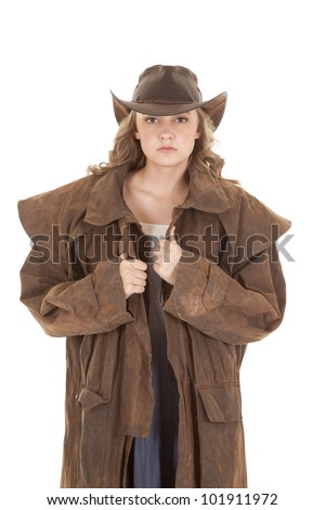 A woman is looking with a cowboy hat and duster on. - stock photo