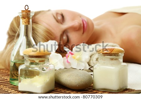 A woman is lying behind spa, cosmetic things - stock photo