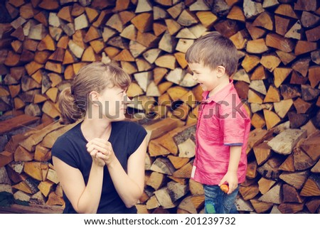 a woman is playing with a boy - stock photo