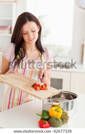 A woman is preparing food for cooking