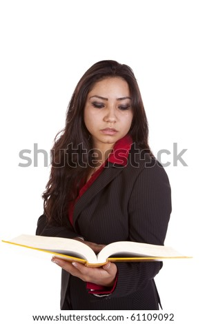 A woman is reading a book with a serious expression - stock photo