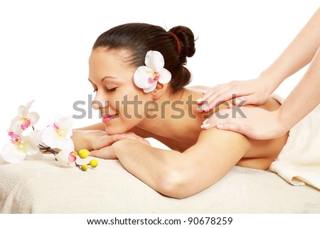 A woman is relaxing during a massage isolated on white background - stock photo