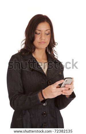 A woman is sending a text on her phone. - stock photo