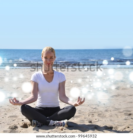 A woman is sitting on the beach with sparkles coming out of her fingers. She is meditating with peace and tranquility. Add your text to the top for copyspace.
