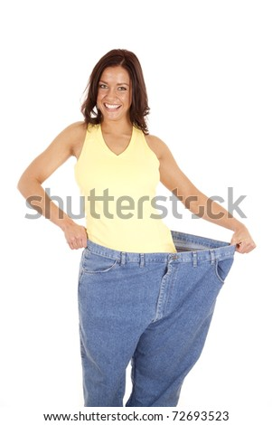 A woman is standing with very large pants on. - stock photo